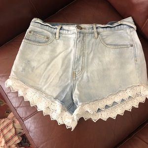 Free people distressed lace denim shorts